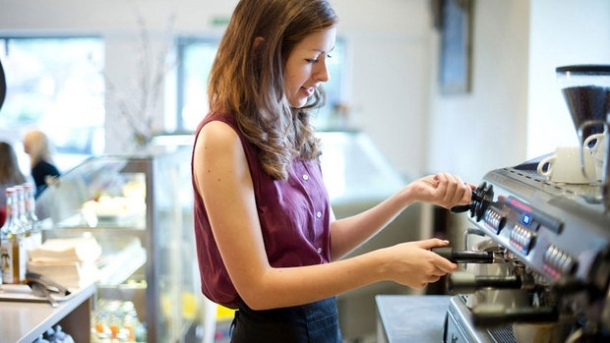 Image of a student operating a coffee maker